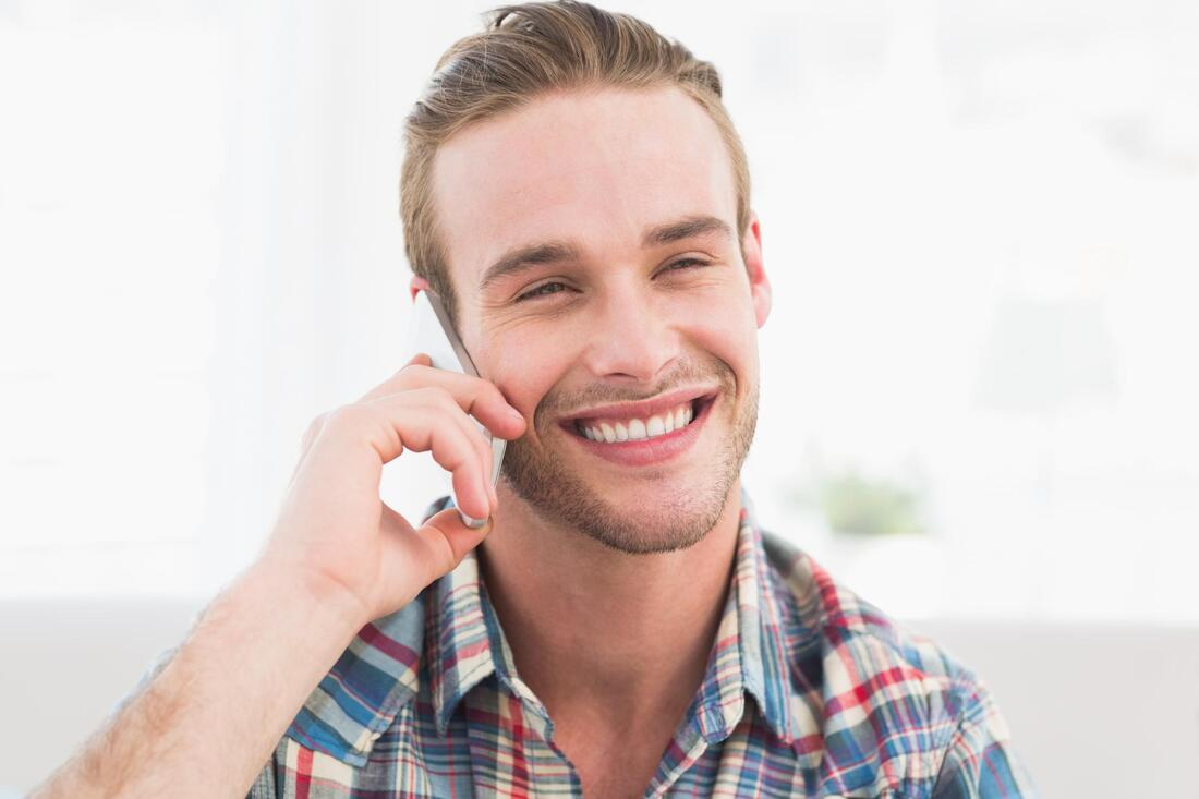 customer service smiling taking phone call